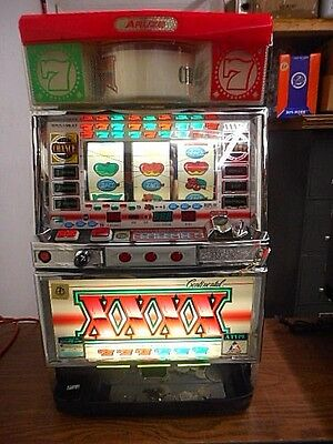 Pachislo Aruze Continental XXXX 4 Reel Slot Machine with Tokens