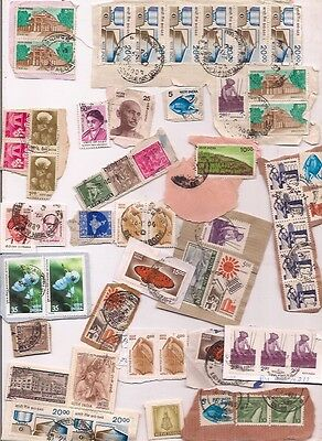 134 INDIA stamps on paper.
