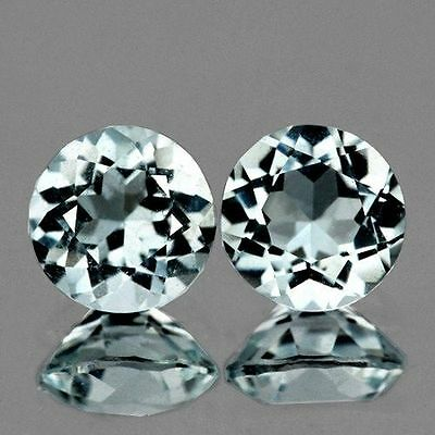 A PAIR OF 4mm ROUND-FACET STRONG AQUA-BLUE LAB AQUAMARINE GEMSTONES