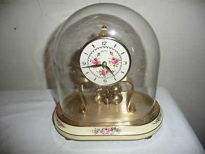 Kern & Sohne Miniature, Right Hand Winder, Anniversary Clock in Oval Glass Dome.