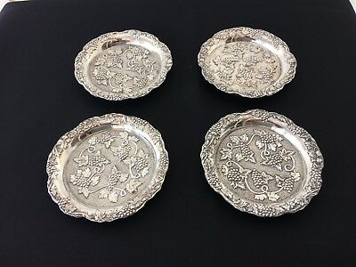 vintage set of four silver plated drinks coasters with lovely fruit pattern