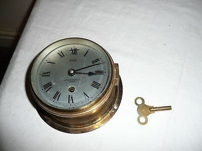 Small, Brass Ships Bulkhead Clock, Signed, Capt O M Watts , London.Working Order