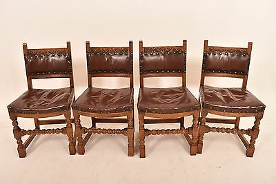 A Set Of Four 20th Century Jacobean Style Oak Dining Chairs