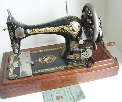 Singer sewing machine serial no: J728052 Nos 127 and 128