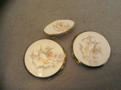 A pair of VINTAGE STRATTON powder compacts