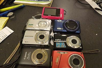 7 cameras kodak sanyo canon nikon vivitar olympus  READ DESCRIPTION