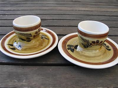 TWO TONI RAYMOND EGG CUPS hand painted