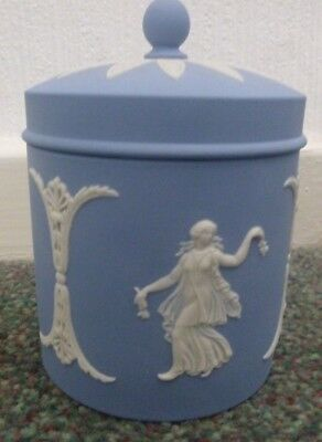 A cylindrical lidded box from Wedgwood, their Jasper Ware design in their blue