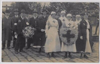 Social History - RED CROSS NURSES & OTHER NURSES WAITING TO LAY A RED X WREATH