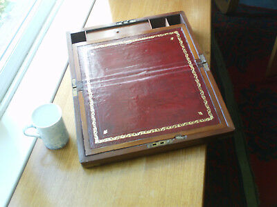 Antique portable writing desk with brass inlay.