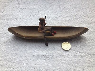 Original Old Red Indian In Wooden Canoe.