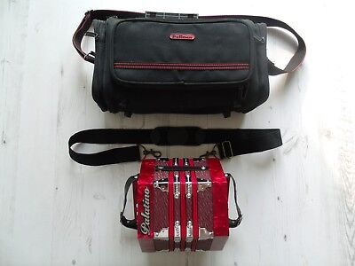 A Red Palatino 20 Key Concertina And Carry Bag