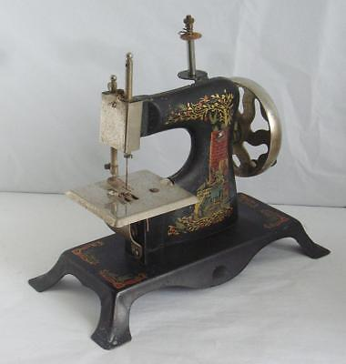 SUPERB ANTIQUE CHILDS SEWING MACHINE GERMAN PAINTED GIRL FEEDING BIRDS,1900/20s