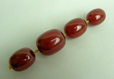 Four Art Deco Cherry Amber Beads From A Necklace 36.5 Grams