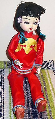 Vintage Taiwanese Seated Doll in Decorated Red Silk