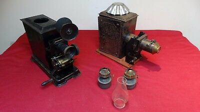 A Pair Of Vintage Hand Cranked German Projectors With Oil Burners.