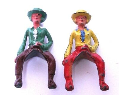 Nice Pair Of Vintage Cast Iron Cowboy Figures Mounted On Saddles