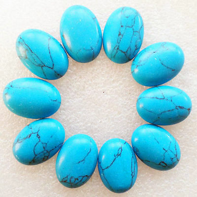 A PAIR OF 14x10mm OVAL CABOCHON-CUT NATURAL CHINESE TURQUOISE GEMSTONES
