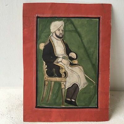 Antique Indian Miniature Painting. A Mughal prince or nobleman seated.