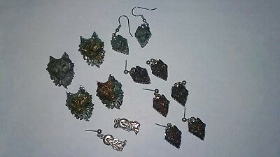 Collection of Wolf Earrings and Pins