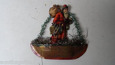 Marvelous Red Coat Santa Claus in Dresden Boat Christmas Ornament