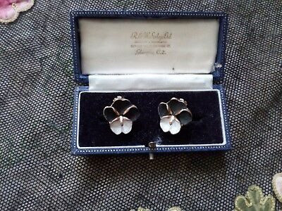 A pair of enamel pansy ear clips c1950s.
