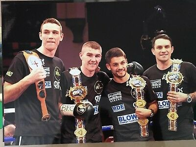 Un signed 12x8 photo of boxing brothers Paul, Stephen, Liam and Callum Smith!