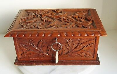 Antique hand carved  box -  carved oak leaf design with key and lock