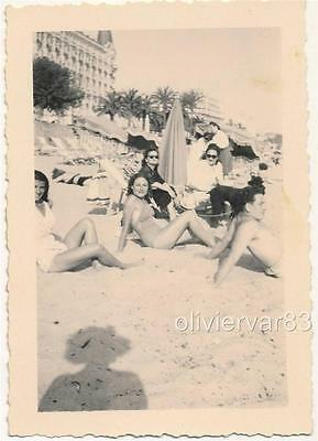 Pretty girls in swimsuit on Cannes, France beach - 1946 vintage photo
