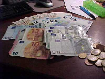 EURO  1371  in common coin and currency below official exchange rate
