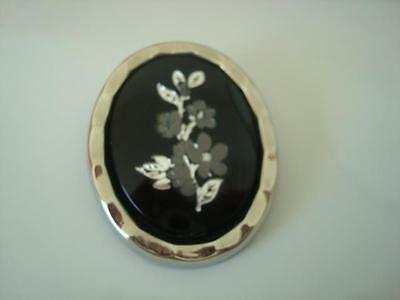 Silver Tone and Black Plastic Scarf Ring Clip With Gray Flowers