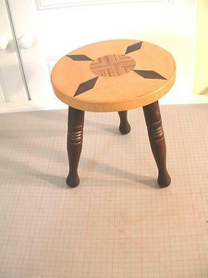 "vintage 3 legged stool / stand with an inlaid top  9.5"" high x 8.25"" dia."
