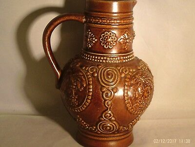 Brown Bellarmine Style Jug With Face Cartoses Going Round Body Not Salt Glazed