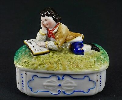 Awesome Victorian Fairing Bisque Porcelain Figural Box of Boy Reading a Book