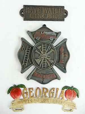 3 Vintage Cast iron pieces inc Georgia Topper Fireman Save Water Drink Beer