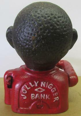"Charming Cast Iron Black Americana ""Jolly N"" Still Coin Bank."