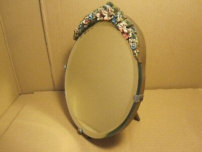 Vintage Mirror. Flower detail at top. Stand at back. Gold colour. As Found.