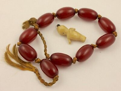 Vintage Art Deco period c 1930's red bead bracelet and baby charm lot