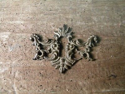 Vintage ornate brass skeleton key hole cover