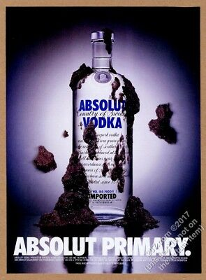 1996 Absolut Primary vodka bottle with mud thrown at it photo vintage print ad