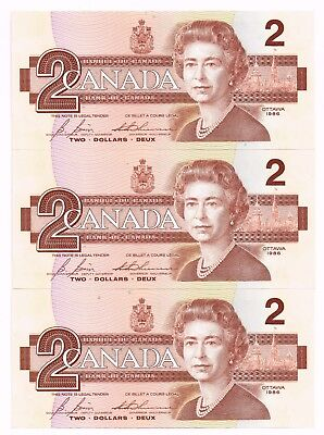 LOT OF THREE 1986 CANADA TWO DOLLARS NOTES - p94c 'IN NUMERICAL SEQUENCE'