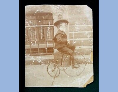 antique VICTORIAN PHOTOGRAPH~LITTLE BOY ON TRICYCLE ~ CUTE grates on windows