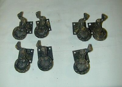 7 Antique Cast Iron Clam Shell Window Shutter Dogs (4 One Hand)(3 The Other )