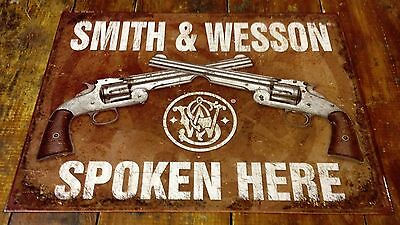 Smith & Wesson Spoken Here Two Crossed Pistols Aged Metal Advertising Sign