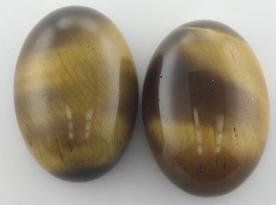 A PAIR OF 14x10mm OVAL CABOCHON-CUT NATURAL GOLDEN TIGERS-EYE GEMSTONES