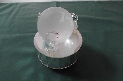 Glass music box. Swans on a mirrored disc and heart etched ball