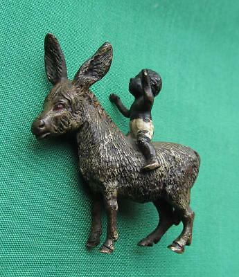 Vintage Miniature Cold Painted Figure Of Negro Boy Riding On A Donkey/Mule/Ass