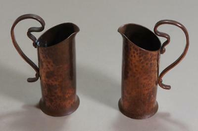 "Arts & crafts pair of 6"" high hammered copper vases with handles"