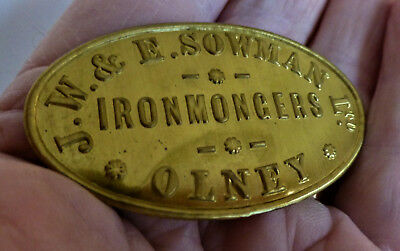 A Small Brass Plaque - W.& E.sowman Ironmongers Olney.