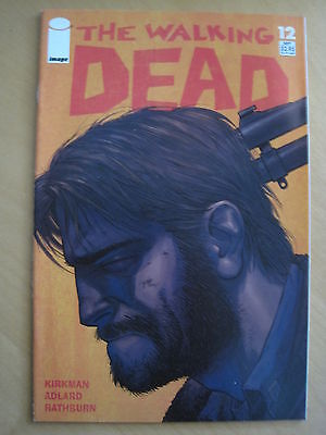 The WALKING DEAD 12. 1st PRINTING by ROBERT KIRKMAN & CHARLIE ADLARD. IMAGE.2004